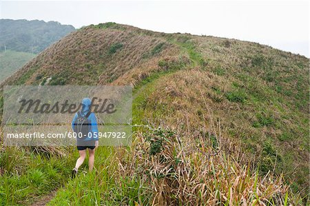 Backview of Woman Hiking, Ilha do Mel, Parana, Brazil Stock Photo - Premium Royalty-Free, Image code: 600-05947922