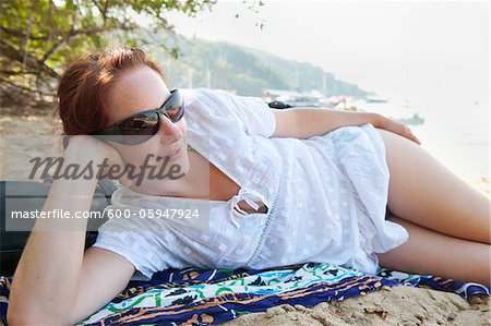 Woman Lying on Beach, Paraty, Costa Verde, Brazil Stock Photo - Premium Royalty-Free, Image code: 600-05947924