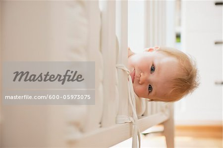 Baby Girl Looking out from Crib Stock Photo - Premium Royalty-Free, Image code: 600-05973075