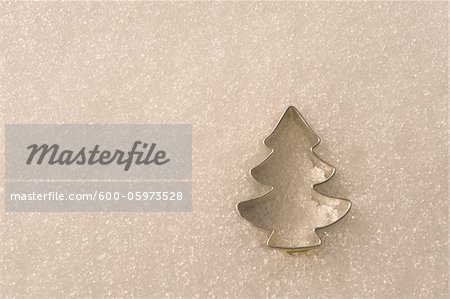 Tree-Shaped Cookie Cutter in Snow Stock Photo - Premium Royalty-Free, Image code: 600-05973528
