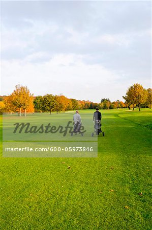 Men on Golf Course, North Rhine-Westphalia, Germany Stock Photo - Premium Royalty-Free, Image code: 600-05973846
