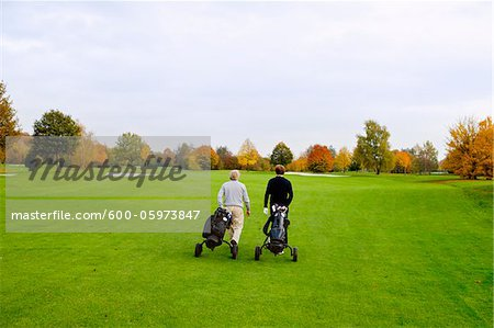 Men on Golf Course, North Rhine-Westphalia, Germany Stock Photo - Premium Royalty-Free, Image code: 600-05973847
