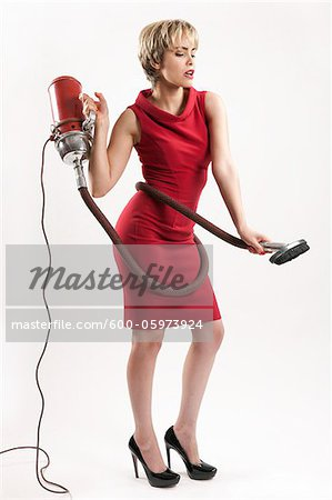 Woman with Vacuum Cleaner Stock Photo - Premium Royalty-Free, Image code: 600-05973924