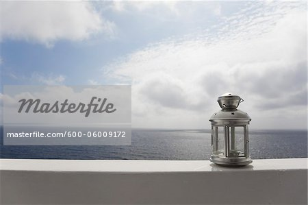 Lantern on Ledge overlooking Sea, Ginostra, Stromboli Island, Aeolian Islands, Italy Stock Photo - Premium Royalty-Free, Image code: 600-06009172