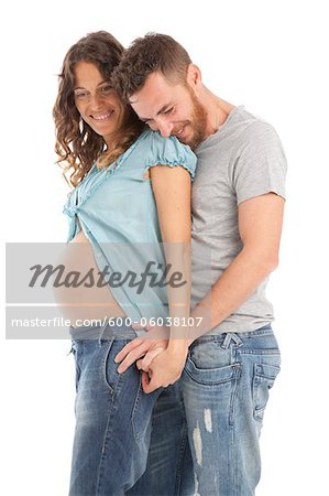 Portrait of Pregnant Couple Stock Photo - Premium Royalty-Free, Image code: 600-06038107