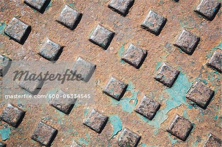 Manhole Cover Stock Photo - Premium Royalty-Free, Image code: 600-06334545