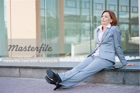 Businesswoman Relaxing Outdoors, Niederrad, Frankfurt, Germany Stock Photo - Premium Royalty-Free, Image code: 600-06355235