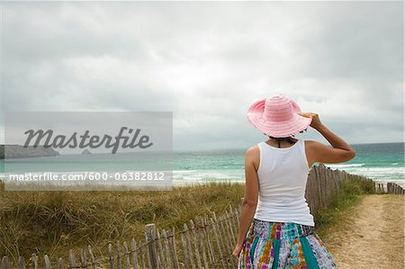 Rear View of Woman on Beach, Camaret-sur-Mer, Crozon Peninsula, Finistere, Brittany, France Stock Photo - Premium Royalty-Free, Image code: 600-06382812