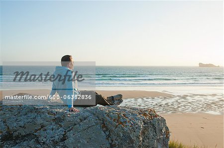 Man Looking into the Distance at the Beach, Camaret-sur-Mer, Crozon Peninsula, Finistere, Brittany, France Stock Photo - Premium Royalty-Free, Image code: 600-06382836