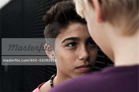 Boys Looking at Each Other, Mannheim, Baden-Wurttemberg, Germany Stock Photo - Premium Royalty-Free, Image code: 600-06382858