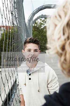 Girl and Boy Talking in Playground, Mannheim, Baden-Wurttemberg, Germany Stock Photo - Premium Royalty-Free, Image code: 600-06382875
