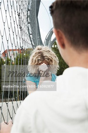 Upset Girl and Boy Talking in Playground, Mannheim, Baden-Wurttemberg, Germany Stock Photo - Premium Royalty-Free, Image code: 600-06382877