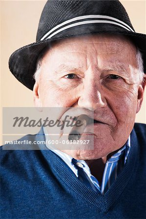 Portrait of Senior Man Smoking Cigar Stock Photo - Premium Royalty-Free, Image code: 600-06382927