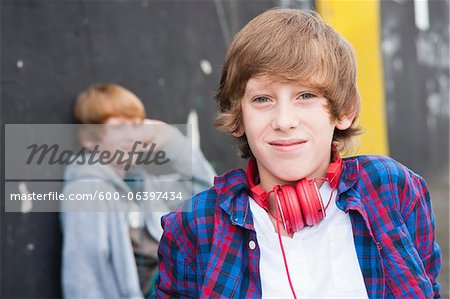 Boys wearing Headphones Outdoors, Mannheim, Baden-Wurttemberg, Germany Stock Photo - Premium Royalty-Free, Image code: 600-06397434