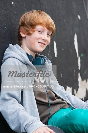 Portrait of Boy wearing Headphones Outdoors, Mannheim, Baden-Wurttemberg, Germany Stock Photo - Premium Royalty-Free, Image code: 600-06397435