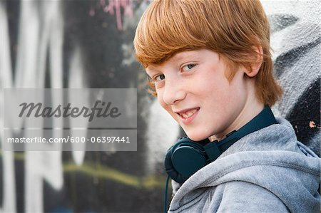 Close-up Portrait of Boy wearing Headphones, Mannheim, Baden-Wurttemberg, Germany Stock Photo - Premium Royalty-Free, Image code: 600-06397441