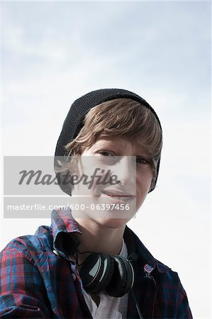 Portrait of Boy wearing Toque and Headphones, Mannheim, Baden-Wurttemberg, Germany Stock Photo - Premium Royalty-Free, Image code: 600-06397456