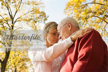 Mature Woman with Senior Father in Autumn, Lampertheim, Hesse, Germany Stock Photo - Premium Royalty-Free, Image code: 600-06397465