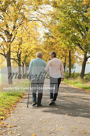 Mature Woman Walking with Senior Father in Autumn, Lampertheim, Hesse, Germany Stock Photo - Premium Royalty-Free, Image code: 600-06397468