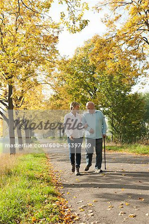 Mature Woman Walking with Senior Father in Autumn, Lampertheim, Hesse, Germany Stock Photo - Premium Royalty-Free, Image code: 600-06397469
