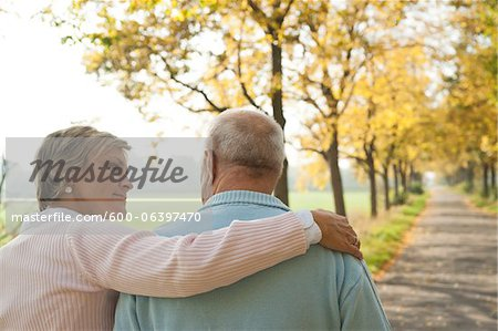 Mature Woman with Arm around Shoulder of Senior Father in Autumn, Lampertheim, Hesse, Germany Stock Photo - Premium Royalty-Free, Image code: 600-06397470