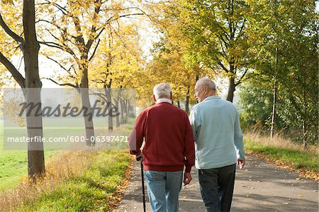 Senior Men Walking on Tree-lined Path in Autumn, Lampertheim, Hesse, Germany Stock Photo - Premium Royalty-Free, Image code: 600-06397471
