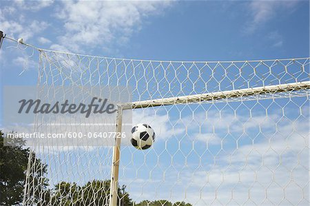 Soccer Ball in Goal, Cap Ferret, Gironde, Aquitaine, France Stock Photo - Premium Royalty-Free, Image code: 600-06407726