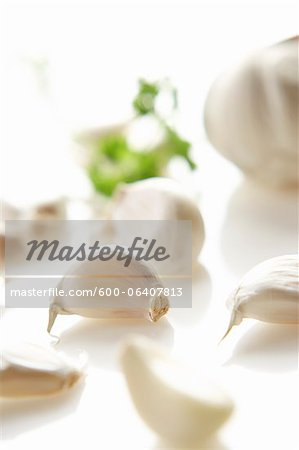 Garlic Cloves on White Background. Stock Photo - Premium Royalty-Free, Image code: 600-06407813