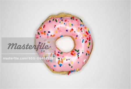 Overhead View of Donut with Pink Icing and Sprinkles Stock Photo - Premium Royalty-Free, Image code: 600-06407916