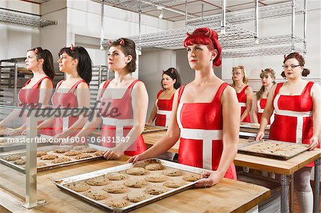 Women Wearing Devil Horns Working at a Bakery, Oakland, Alameda County, California, USA Stock Photo - Premium Royalty-Free, Image code: 600-06431347