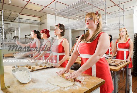 Women Wearing Devil Horns Working at a Bakery, Oakland, Alameda County, California, USA Stock Photo - Premium Royalty-Free, Image code: 600-06431354