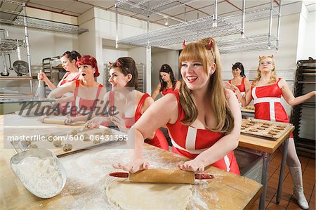 Women Wearing Devil Horns Working at a Bakery, Oakland, Alameda County, California, USA Stock Photo - Premium Royalty-Free, Image code: 600-06431355