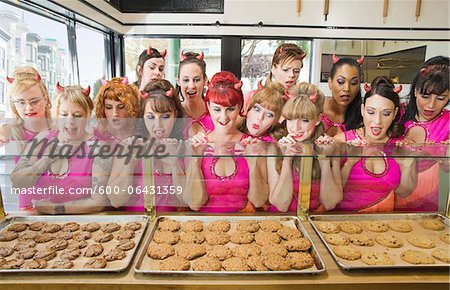 Women Wearing Devil Horns at a Bakery, Oakland, Alameda County, California, USA Stock Photo - Premium Royalty-Free, Image code: 600-06431359