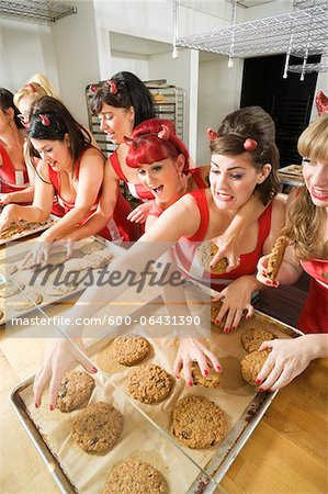 Women Wearing Devil Horns at a Bakery, Oakland, Alameda County, California, USA Stock Photo - Premium Royalty-Free, Image code: 600-06431390