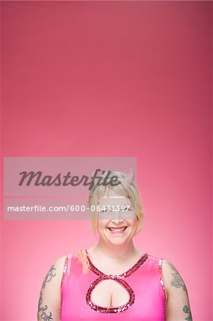 Portrait of Woman Wearing Devil Horns Stock Photo - Premium Royalty-Free, Image code: 600-06431397