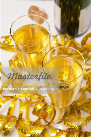 Two Glasses of Sparkling Wine and Streamers Stock Photo - Premium Royalty-Free, Image code: 600-06438861