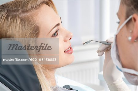 Young Woman getting Check-up at Dentist's Office, Germany Stock Photo - Premium Royalty-Free, Image code: 600-06438883
