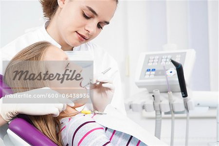 Dentist Checking Girl's Teeth during Appointment, Germany Stock Photo - Premium Royalty-Free, Image code: 600-06438936