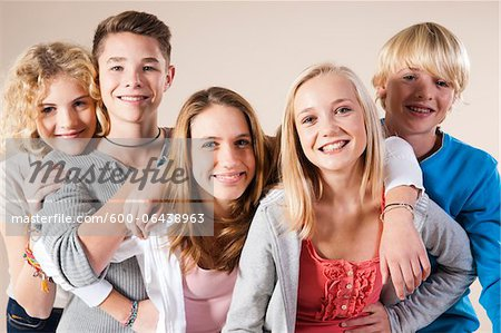 Portrait of Group of Teenage Boys and Girls Smiling at Camera, Studio Shot on White Background Stock Photo - Premium Royalty-Free, Image code: 600-06438963