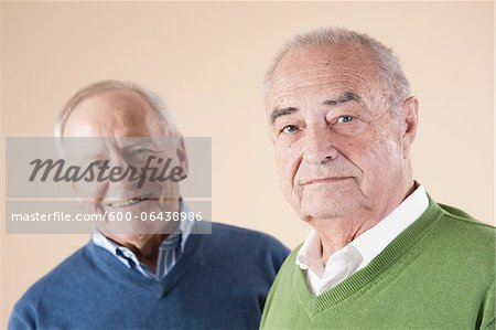 Portrait of Two Senior Men Looking at Camera, Studio Shot on Beige Background Stock Photo - Premium Royalty-Free, Image code: 600-06438986