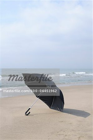 Open Umbrella on Beach, Port Camargue, Grau du Roi, Gard, Languedoc-Roussillon, France Stock Photo - Premium Royalty-Free, Image code: 600-06451962