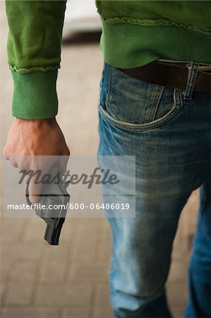 Close-up of Young Man holding Handgun, Mannheim, Baden-Wurttemberg, Germany Stock Photo - Premium Royalty-Free, Image code: 600-06486019