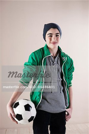 Portrait of Boy with Soccer Ball in Studio Stock Photo - Premium Royalty-Free, Image code: 600-06486401