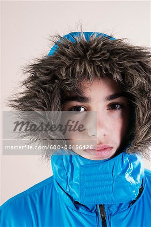 Portrait of Boy in Winter Jacket with Faux Fur Trimmed Hood in Studio Stock Photo - Premium Royalty-Free, Image code: 600-06486426