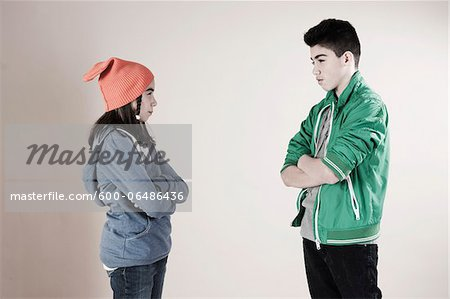 Boy and Girl Arguing in Studio Stock Photo - Premium Royalty-Free, Image code: 600-06486436