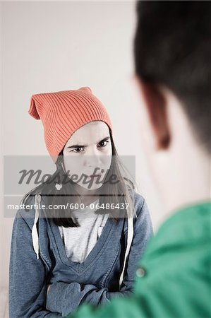 Boy and Girl Arguing in Studio Stock Photo - Premium Royalty-Free, Image code: 600-06486437
