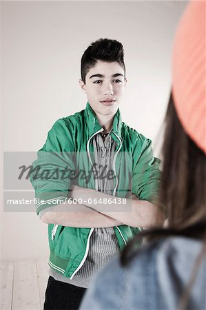 Boy and Girl Arguing in Studio Stock Photo - Premium Royalty-Free, Image code: 600-06486438