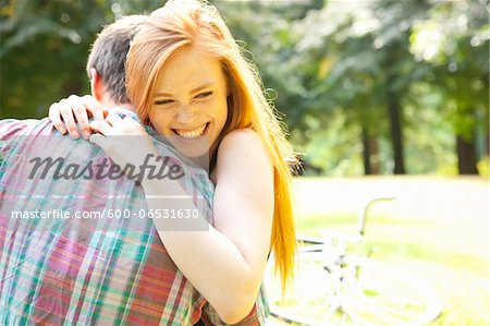 Young Couple Hugging in Park on a Summer Day, Portland, Oregon, USA Stock Photo - Premium Royalty-Free, Image code: 600-06531630