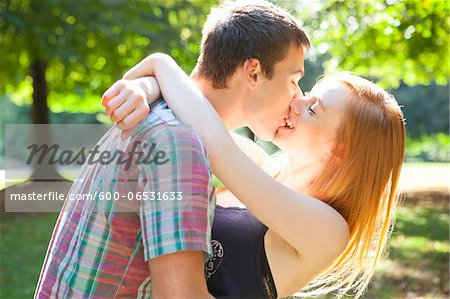 Young Couple Kissing in Park on a Summer Day, Portland, Oregon, USA Stock Photo - Premium Royalty-Free, Image code: 600-06531633