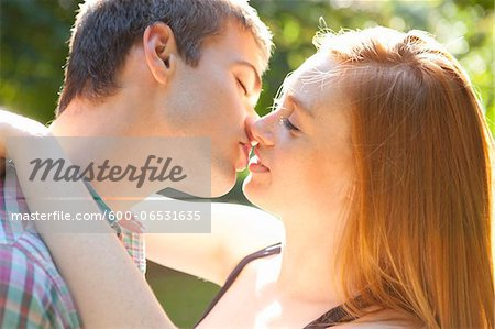 Young Couple Kissing in Park on a Summer Day, Portland, Oregon, USA Stock Photo - Premium Royalty-Free, Image code: 600-06531635